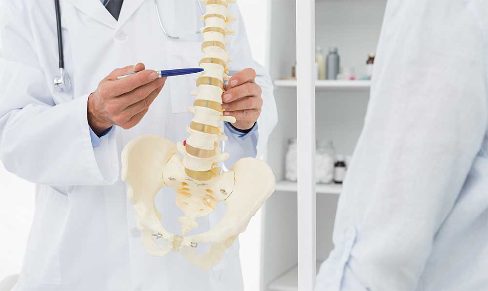Chiropractor talking to a patient